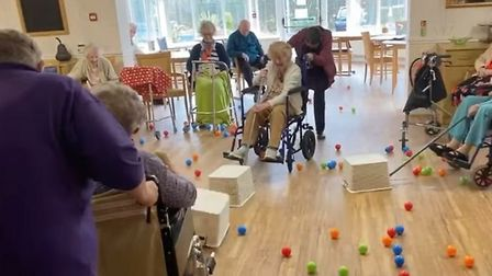 Residents of Bryn Celyn Care Home play a life-size version of Hungry Hippos. Photograph: Facebook.