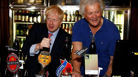 Boris Johnson during a visit to Wetherspoons Metropolitan Bar in London with Tim Martin, chair of JD