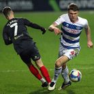 Brentford's Sergi Canos (left) and Queens Park Rangers' Rob Dickie battle for the ball during the Sk
