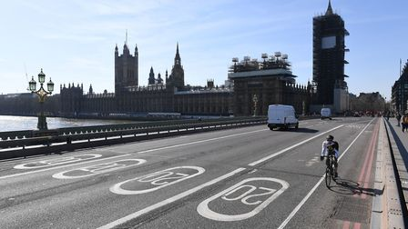 A near empty Westminster Bridge and the Houses of Parliament in Westminster, the day after Boris Jo
