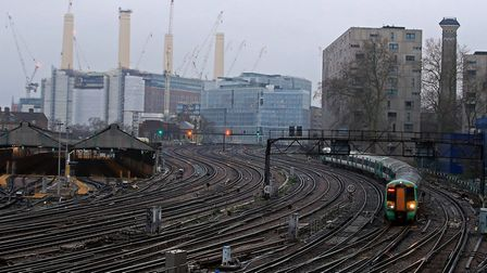 A train approaches Victoria Station in London during the week the government suspended rail franchis