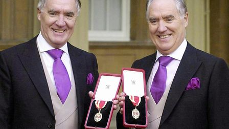 Sir David Barclay (L) and his twin brother Sir Frederick posing after receiving their knighthoods fr