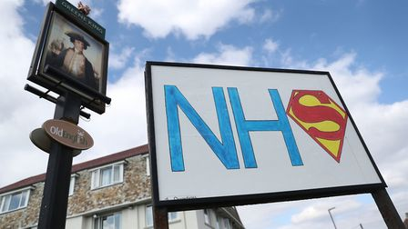 A sign showing support for the NHS outside The Commodore pub in Bournemouth. Photograph: Andrew Matt