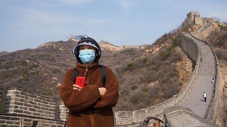 A Chinese tourist visits the reopened Great Wall on Marc 24. It had been closed from January 25 foll