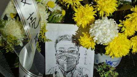 Floral tributes to Li Wenliang, the doctor who was punished after raising the alarm about the new co