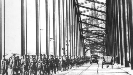 Men of the First Battalion Scots Guards marching over the Hohenzollern Bridge during the British occ