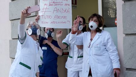 Medical staff from Rome's Forlanini Hospital step out with protective masks to join a flash mob perf
