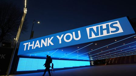 A sign by Wembley Park Tube Station in London that thanks the hardworking NHS staff who are trying t