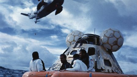 In the Pacific Ocean, Astronauts from Apollo 13, Fred Haise (L), John Swigert and James Lovell (R) a