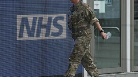 A member of the military at the ExCel centre in London which is being made into a temporary hospital