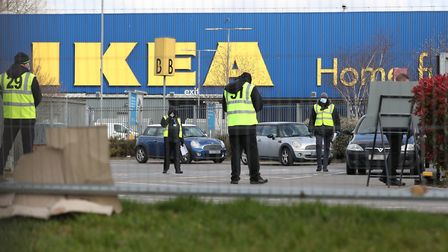 Stewards organise traffic at a coronavirus test centre for NHS workers which has opened at Ikeas st