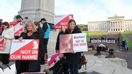Pro Life and Pro Choice activists take part in a photocall in the grounds of Stormont Parliament, Be