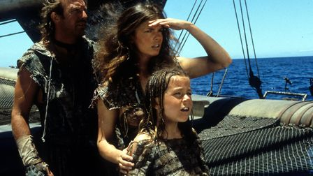 Kevin Costner, Jeanne Tripplehorn and Tina Majorino look to the horizon in a scene from the film 'Wa