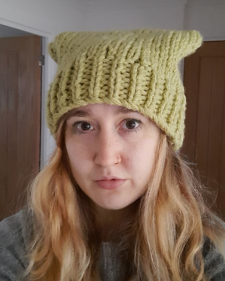 Abygail Tustin from Potters Bar, wearing a hat she knitted while on furlough