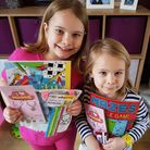 Lily, 8, andScarlett, 5, from Huntingdon, with their activity packs.