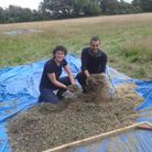 Craig Dunton, right, with harvested wildflower seed