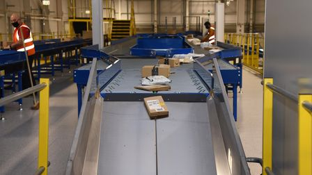 The parcels are passed down conveyor belts where they are sorted into the correct areas Picture: CH