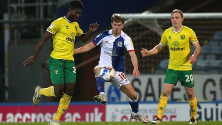 Alexander Tettey of Norwich, Jacob Davenport of Blackburn Rovers and Oliver Skipp of Norwich in acti