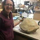 Dr Ruth Shaffrey from Oxford Archaeology with the millstone.