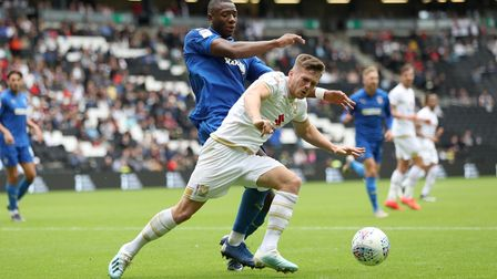 Former Cardiff and MK Dons' striker Rhys Healey is attracting interest from clubs in England after a goalscoring spell at...
