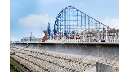 Blackpool pleasure beach and big one with tower in distance.
