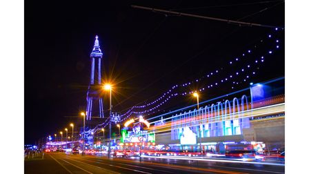 The Famous Blackpool Tower and lights along the stretch of promenade known as the Golden Mile in Bla