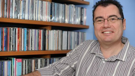 Radio Caroline presenter Stephen 'Foz' Foster at home with his CD collection