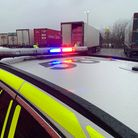 Police with the lorry which had travelled up the M11 and along the A14