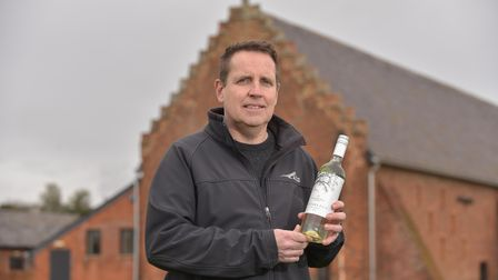 Ian Evans, owner of Copdock Hall and Vineyard with their new wine, Foster's Fate.