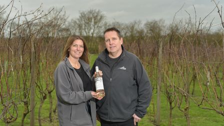 Ian and Diane Evans, owners of Copdock Hall and Vineyard with their new wine, Foster's Fate. Pictur