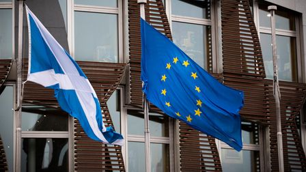 The Saltire and EU flag fly outside the Scottish Parliament in Edinburgh. Today MSPs vote on whether