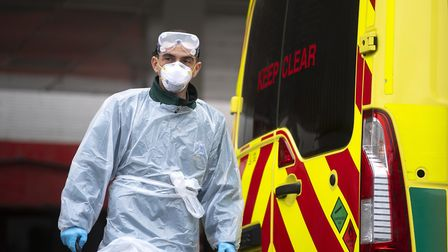 A London Ambulance worker wearing PPE at St Thomas' Hospital in London as the UK continues in lockdo