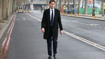 Former Labour party leader Ed Miliband walks along Victoria Embankment in London.
