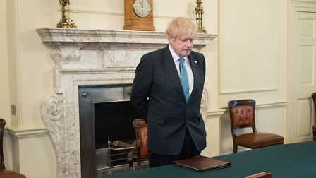 Prime Minister Boris Johnson in the Cabinet Room inside 10 Downing Street, London, to observe a minu