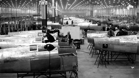 Workers in the assembly area of an aircraft factory in the Midlands, building spitfires. (Photo by