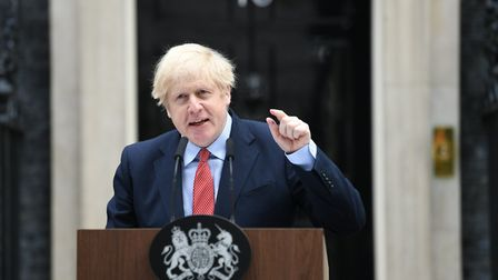 Prime Minister Boris Johnson makes a statement outside 10 Downing Street, London, as he resumes work