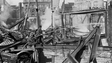 Damping down the fires in the ruins of Curls Store,Rampant Horse Street, April 30, 1942 Pictur
