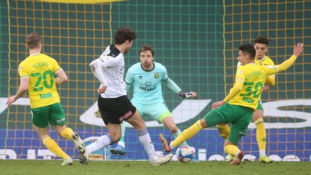 Tim Krul of Norwich, Dimitris Giannoulis of Norwich and Max Aarons of Norwich combine to block a sh