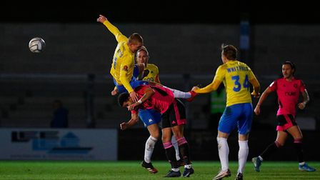 Jake Andrews of Torquay United challenges for the aerial ball with Jamie Allen of FC Halifax Town du