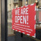 Shops reopening with new social distancing rules following Coronavirus closures. 'Open' sign in shop