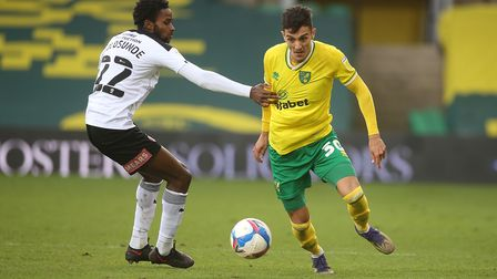 Matthew Olosunde of Rotherham United and Dimitris Giannoulis of Norwich in action during the Sky Bet