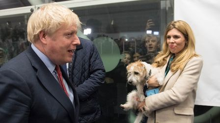 Boris Johnson and Carrie Symonds with their dog Dilyn
