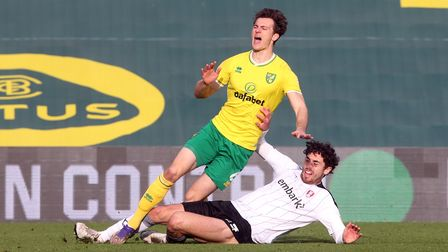 Christoph Zimmermann of Norwich is fouled by Matt Crooks of Rotherham United during the Sky Bet Cham
