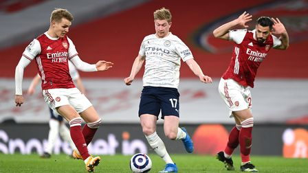 Arsenal's Martin Odegaard and Manchester City's Kevin De Bruyne battle for the ball