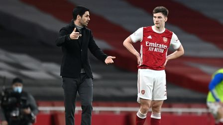 Arsenal manager Mikel Arteta and Kieran Tierney in discussion at Emirates Stadium