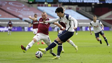 West Ham United's Vladimir Coufal (left) attempts to block a cross from Tottenham Hotspur's Son Heun