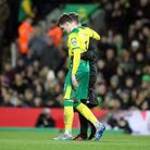 Sam Byram of Norwich stretches for the ball but pulls what looks like his Hamstring and has to leave