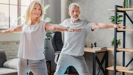 A man and woman practise yoga