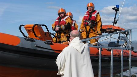 Reverend Philip Auden with RNLI volunteers.