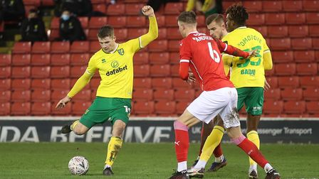 Jacob Sorensen of Norwich has a shot on goal during the FA Cup match at Oakwell, BarnsleyPicture b